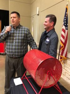 Chairman Lion Warner Phelps, left, asks State Senator Brandon Creighton, right, to pull the tickets for the 24 finalists who will return for the Lucky Derby Car Raffle on Wednesday to vie for a brand new 2018 Chevrolet Equinox donated by Buckalew Chevrolet.
